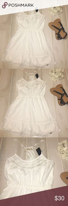 Hollister dress Cute white Hollister jeweled racerback dress. Cinched waist. Laced hem. Jeweled and scalloped top. Adjustable straps with a racer style back. Size s. NWT Hollister Dresses Mini