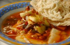 Asinan Bogor, mix fruit and vegetables + nut... in a spicy soup, http://dodonjerry.blogspot.com/2011/05/asinan-bogor-cemilan-makan-siang.html