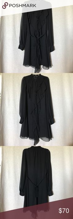 💏 Armani Exchange Dress 👫 Perfect little black dress 👗. Only worn once and in perfect condition. 💯 % silk  Fully lined with 55% Polyester 45% Viscose. Can be worn as a loose fit as well. Sheer accents with a front ruffle and buttons from top to bottom. AX Armani Exchange Dresses