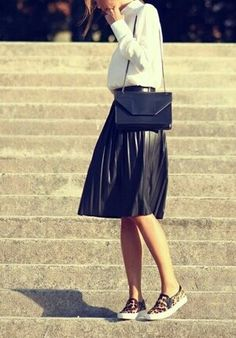 Great tomboy or sporty look. Leopard snickers, black skirt and great white blouse