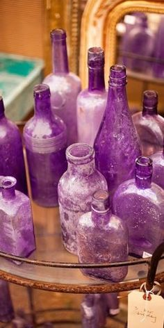 Antique lavender glass bottles. I was gone for like half the day looking at stuff like this, and know I'm like obsessed with it, antiques, and antique shopping!!