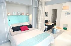 Simple modern bedroom with sky blue headboard. Chambre by Sandra Dages.
