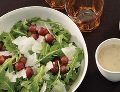 Roasted grapes and a homemade shallot vinaigrette turn a simple salad into a spectacular side dish or first course.   Arugula Salad with Roasted Grapes , 4.0 out of 4 based on 2 ratings