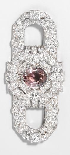 An Art Deco platinum, diamond and tourmaline brooch.