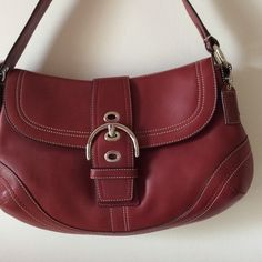 Coach red leather Soho shoulder bag.  NWOT Gorgeous red Coach leather shoulder bag.  Magnetic closer, large back pouch.  Inside pouches and zippered pocket.   032330 Coach Bags Shoulder Bags