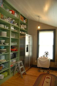 Interesting Pantry Ideas for Inspiring Kitchen Storage Design : Sloped Ceiling With Pendant Lighting And Natural Lighting Plus Table Fan Also Wood Floor With Pattern Rug And Refrigerator Plus Pantry Ideas Also Glass Window For Farmhouse Kitchen Design