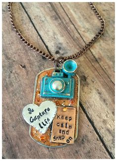 Keep Calm and Snap on...Capture Life Mixed metal rustic camera dog tag necklace. PLEASE NOTE: These pieces are hand stamped and hand painted. They