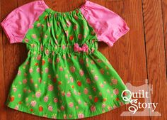 Quilt Story: Baby Girl Peasant Top DIY. Sweet little baby shirt with Heather Ross Strawberries from Briar Rose. Love this green on my baby girl!