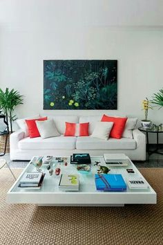 The coral pillows make this room