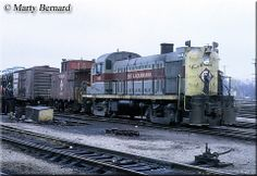 Erie Lackawanna RS3 #1016 switches a train through the yard at Hammond, Indiana on April 2, 1971