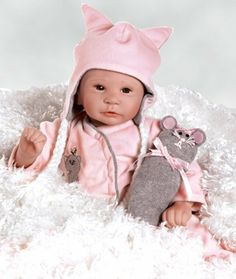 Lifelike Baby Dolls, Merry Mouse, 17 inch Baby With Weighted Body (Artist: Laura Lee Eagles) by Paradise Galleries. $69.50. What happens when you mix a kitty cat with a plush mouse?   The result will surely be wonderful fun and cuteness with these PURR-FECT companions!  As she looks at you with her merry brown eyes and sweet pout, you will want to cuddle this life like baby doll in your arms and hold her small paws playfully!   This mousey babe is certainly the dream kitty cat of...