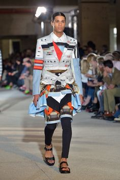 """I'm just going to wear my flip-flops with my Geiger Counter shorts and matching blazer shirt. Oh, and I guess I'll wear some leggings underneath, and tie this matching sweatshirt around my waist in case it gets cold,"" says this guy who walked the Givenchy Menswear runway. (Photo by; Dominique Charriau/WireImage)"
