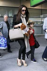 nude shoes, bag, & scarf with black top and skinnies. Victoria Beckham outfit