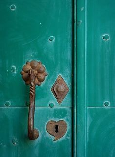 A weathered door of turquoise...