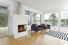 Fireplace in livingroom #design #chimney #finland #unique #härmäair