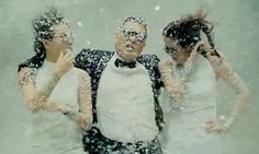 Gangnam Style --- He just ignores the fake snow, but the girls are not up to snuff.  I like that you can see a smile before one of them gets it under control.  You should watch the making of video.  They all crack up :)