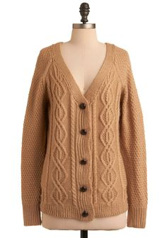 Caramel Latte Cardigan. Ducking into your local cafe to seek shelter from the swirling snowstorm outside, you tuck your mittens into the side pockets of your toasty-warm sweater and claim your preferred corner chair before ordering a mug of your favorite caramel confection. #modcloth