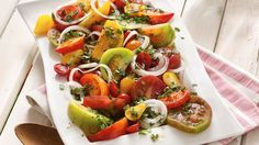 Great-tasting tomatoes are drizzled with a simple oil-and-vinegar dressing to create a showstopping salad.