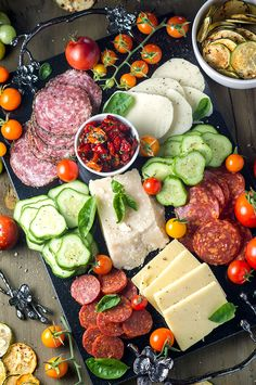 An amazing Summer Garden Antipasto Platter sure to impress at any house party! Stock it full of summer veggies, cured meats, and cheeses! (Cheese Board)