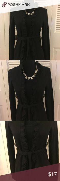 """KRISTIN DAVIS black ruffled cardigan. KRISTIN DAVIS black ruffled cardigan with matching belt at waist. This gorgeous cardigan has a ruffle along both sides and ties at the waist. Perfect with a skirt for the office or with jeans for an equally stylish look. Bust 17"""" L 26.5"""". Kristin Davis Sweaters Cardigans"""