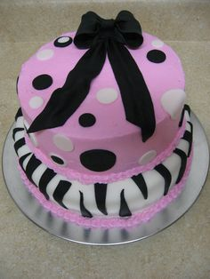 CAKE! Here is a cute birthday cake I made for a little girl. Chocolate and vanilla cakes layered in, pink frosting on top, fondant on bottom and the decorations are fondant as well. My first big cake, bow and zebra stripes! Hope she likes it!