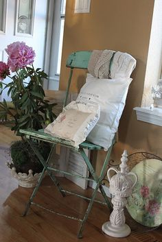 Love this shabby chic look.  Gorgeous chair.