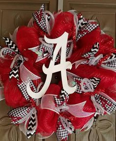 This is a 24 Alabama Crimson Tide deco mesh wreath. It is made of red and white mesh with houndstooth and black and white chevron ribbon, with a 10 white Alabama wooden script A in the center. Christmas Mesh Wreaths, Christmas Swags, Deco Mesh Wreaths, Christmas Time, Winter Wreaths, Christmas Ideas, Alabama Wreaths, Chevron Ribbon, Sports Wreaths