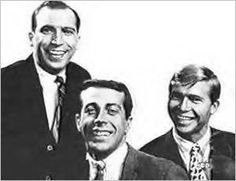 The Mitchell Trio:  Mike Kobluk, Joe Frazier, and John Denver from left to right.