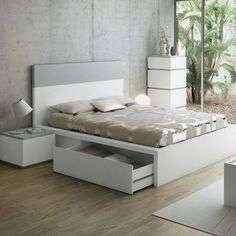 The super stylish Twist Bed by TemaHome features a pure white frame with a contrasting matt grey headboard detail. http://www.nuastyle.com/beds/770-twist-storage-bed-by-temahome.html