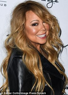 Mariah Carey flaunts her curvy derriere in VERY saucy stockings