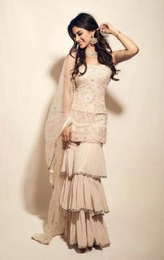 Mouni Roy in a ruffle salwar kameez Party Wear Indian Dresses, Designer Party Wear Dresses, Indian Gowns Dresses, Indian Fashion Dresses, Dress Indian Style, Indian Wedding Outfits, Indian Designer Outfits, Bridal Outfits, Pakistani Dresses