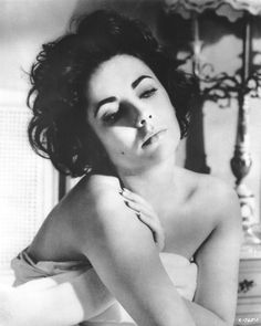 "Elizabeth Taylor in ""Cat on a Hot Tin Roof,"" 1958. Maggie the cat sure knew how to smoulder."