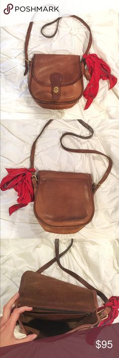Vintage Coach Saddle Bag Beautiful classic Coach Saddle bag. Genuine brown leather. Leather is slightly worn, scratches could be buffed out. Hardware is antique brass. Includes complimentary red silk scarf (in pictures). Make an offer!  Coach Bags Crossbody Bags