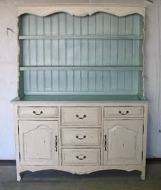 Large Country French style sideboard with hutch in distressed painted finish. Main body the color of warm biscuits with soft sea foam interior.    Farmhouse Sideboard with Hutch | $2895  New & Imported. 85 high X 63 wide X 18 deep. Tinnin Imports
