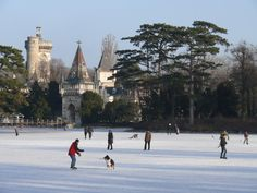 Winter ice skating on the lake surrounding Schloss Laxenburg. In summer you can rent small boats to enjoy paddling around,