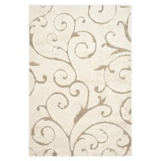 Lend a touch of textured appeal to your dining room or master suite with this elegant shag rug, showcasing a beautiful scrolling motif in cream and beige hue...