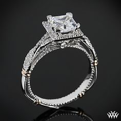 Verragio Princess Halo Diamond Engagement Ring This Diamond Engagement Ring is from the Verragio Parisian Collection. It features 0.30ctw of Round Brilliant Diamond Melee (F/G VS) that enhance a princess diamond center of your choice. All variants are shown with Rose Gold shoulders but are customizable to suit your taste.