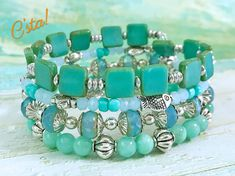 Aqua Blue Memory Wire Bracelet With Free Earrings • Beads: Square Czech Glass, Aqua Faceted Czech Glass Rondelles, Turquoise Czech Glass Seed Beads, Light Blue Faceted Chalcedony, Natural Apatite Nuggets, Round Aqua Quartzite (Largest beads are 10mm & smallest are 4mm). • Charms:
