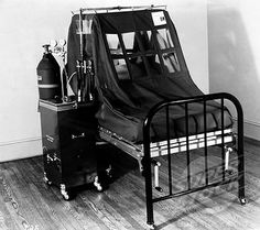 Close-up of an oxygen tent in a hospital.....I remember being in the hospital when I was 5 & was in one similar to this. I still remember the claustrophobia.
