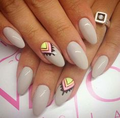 Nude oval set with tribal accents by @ikabod.nail