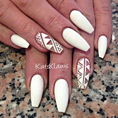 Matte white Coffin nails with negative space design- Don't really care for the nail shape, but the design is cool