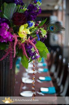 i love peacock feathers, amaranthus, purple stock, bells of Ireland, green cymbidium orchids. Amber gems