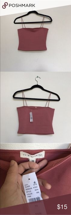 NWT Pacsun Tube top Last chance to get, donating on 1/23!! NWT Pacsun LA Hearts mauve tube top. Perfect condition, no flaws! There's not much stretch to them in the bust area, but they have elastic straps that do stretch. LA Hearts Tops Crop Tops