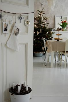 white Christmas--->love the twine hanging from the door with pictures and stocking