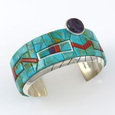 "Sterling Silver Cuff Bracelet with Mosaic Inlaid Blue Gem Turquoise, Mediterranean Coral, and Sugilite Including an Offset Sugilite Cabochon. 1.25"" Cuff Width 5"