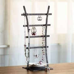 LADDER JEWELRY STAND - A place for every trinket in this hand-forged jewelry stand complete with a porcelain tray for rings and more.