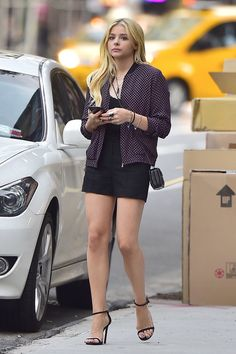 Chloe Moretz sexy legs in black shorts and ankle strap high heels