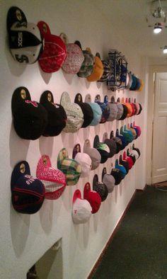 Diy hat rack i used a curtain rod shower curtain hooks for Baseball hat storage ideas
