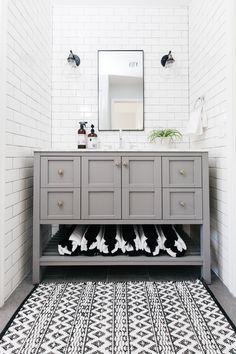 Our Guest Bathroom Remodel. Subway tile with gray grout, light gray vanity, gray floor tile | The TomKat Studio