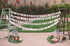 Hanging plan between vintage ladders | 8 Creative Seating Plan Ideas | Blog Post from Vintage Partyware | Vintage and Boho styling and hire for weddings, parties and events in Norfolk, Lincs and Cambs.